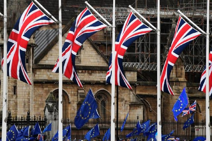 British Union Jack and EU flags are seen during a protest outside the Houses of Parliament in London, Britain, January 30, 2020 — Reuters/Files