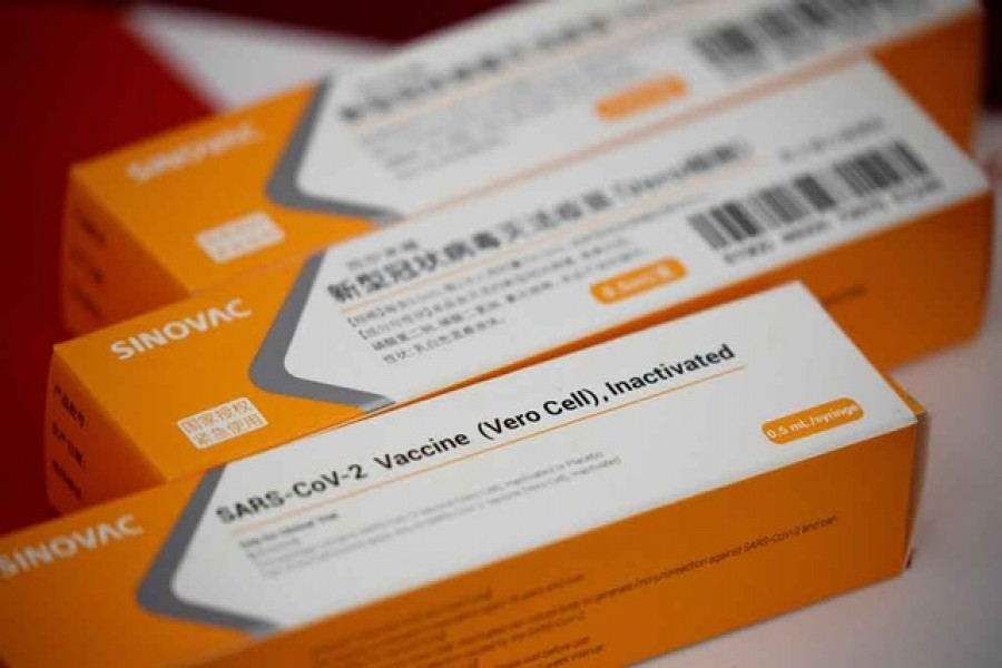 A display shows packages of vaccine candidate for SARS-CoV-2 by Sinovac Biotech during a government-organised media tour showcasing the company's development of a coronavirus disease (COVID-19) vaccine candidate in Beijing, China, Sept 24, 2020. REUTERS