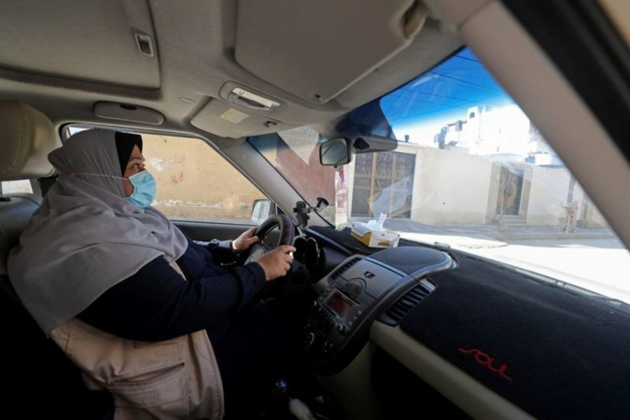 Palestinian woman Naela Abu Jibba, who started a women-only taxi service in Gaza Strip, drives her vehicle at Beach refugee camp in Gaza City Nov 17, 2020. REUTERS
