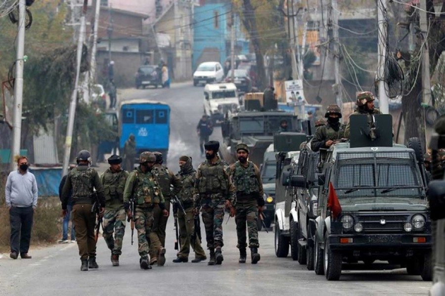 Indian soldiers leave a gun battle site after a suspected militant commander was killed in a gun battle between Indian security forces and suspected militants, at Rangreth on the outskirts of Srinagar, Nov 1, 2020. REUTERS