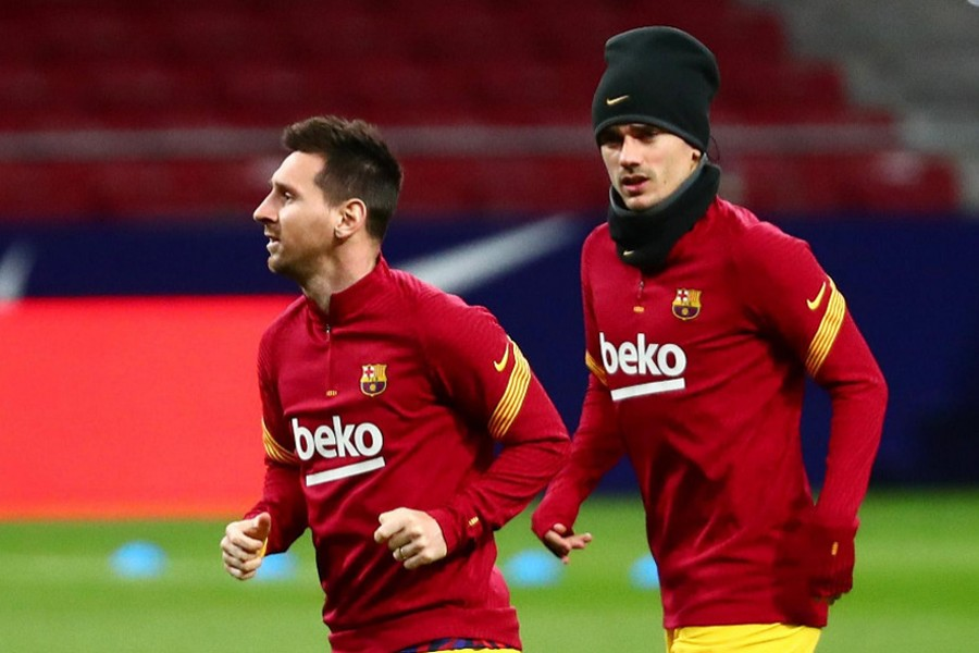 Barcelona's Lionel Messi and Antoine Griezmann during the warm up before the match against Atletico Madrid at Wanda Metropolitano on November 21, 2020 — Reuters/Files