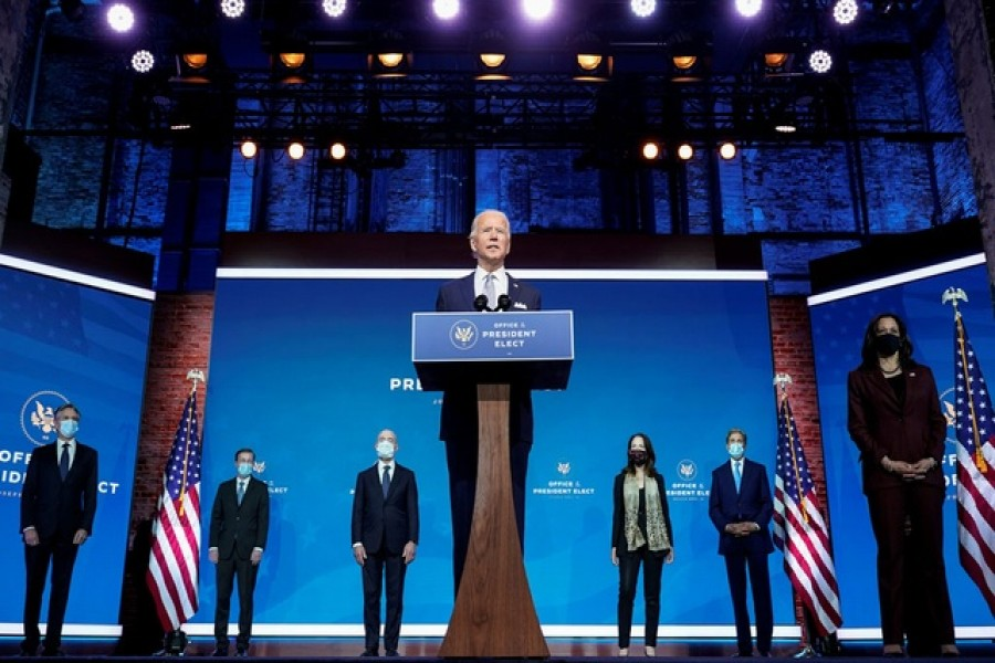 President-elect Joe Biden stands with his nominees for his national security team at his transition headquarters in the Queen Theater in Wilmington, Delaware, US, November 24, 2020. (L-R), are: Antony Blinken to be secretary of state; Jake Sullivan to be US national security adviser; Alejandro Mayorkas to be secretary of Homeland Security; Avril Haines to be director of national intelligence; John Kerry to be a special envoy for climate change; and Ambassador to the United Nations-nominee Linda Thomas-Greenfield, who stands behind Vice President-elect Kamala Haris -- Reuters