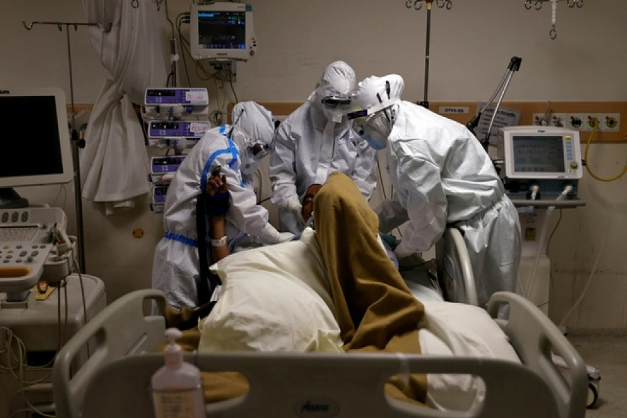 Representational Image: Medical workers wearing personal protective equipment (PPE) take care of a patient suffering from the coronavirus disease (COVID-19), at the Intensive Care Unit (ICU) of the Max Smart Super Speciality Hospital in New Delhi, India, May 28, 2020. Reuters