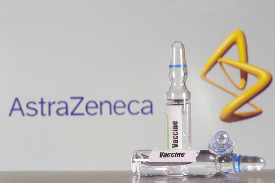 A test tube labelled with the vaccine is seen in front of AstraZeneca logo in this illustration taken on September 9, 2020 — Reuters/Files