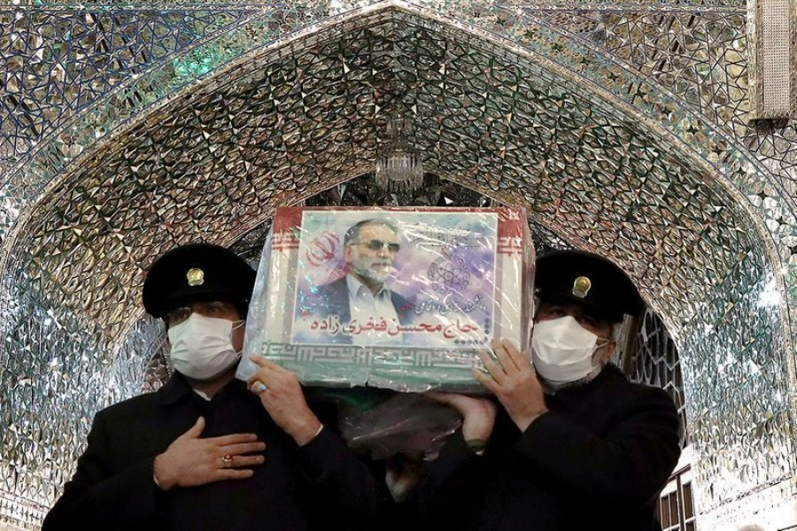 Servants of the holy shrine of Imam Reza carry the coffin of Iranian nuclear scientist Mohsen Fakhrizadeh, in Mashhad, Iran on November 29, 2020 — West Asia News Agency via REUTERS