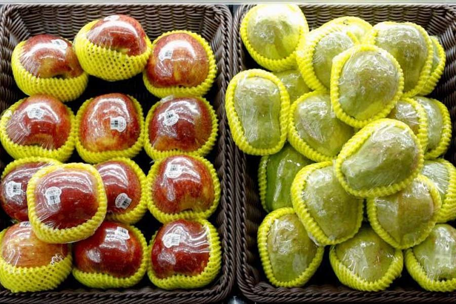 Fruit packaged in plastic are on display at a supermarket in Beijing –Reuters file photo