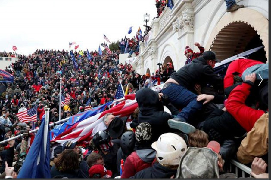 Pro-Trump protesters storm into the US Capitol during a rally to contest the certification of the presidential election results, January 06, 2020. REUTERS/Shannon Stapleton