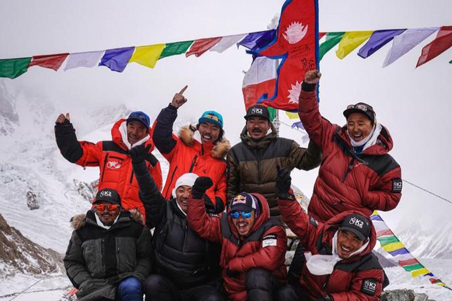 "Nirmal ""Nims"" Purja, Dawa Tenji Sherpa (team MG), Mingma G, Dawa Temba Sherpa and Pem Chiri Sherpa, Mingma David Sherpa, Mingma Tenzi Sherpa, Nimsdai Purja and Gelje Sherpa are seen during the Puja ceremony before the winter attack on K2, Pakistan on January 5, 2021 — RED BULL CONTENT POOL/Handout via REUTERS"
