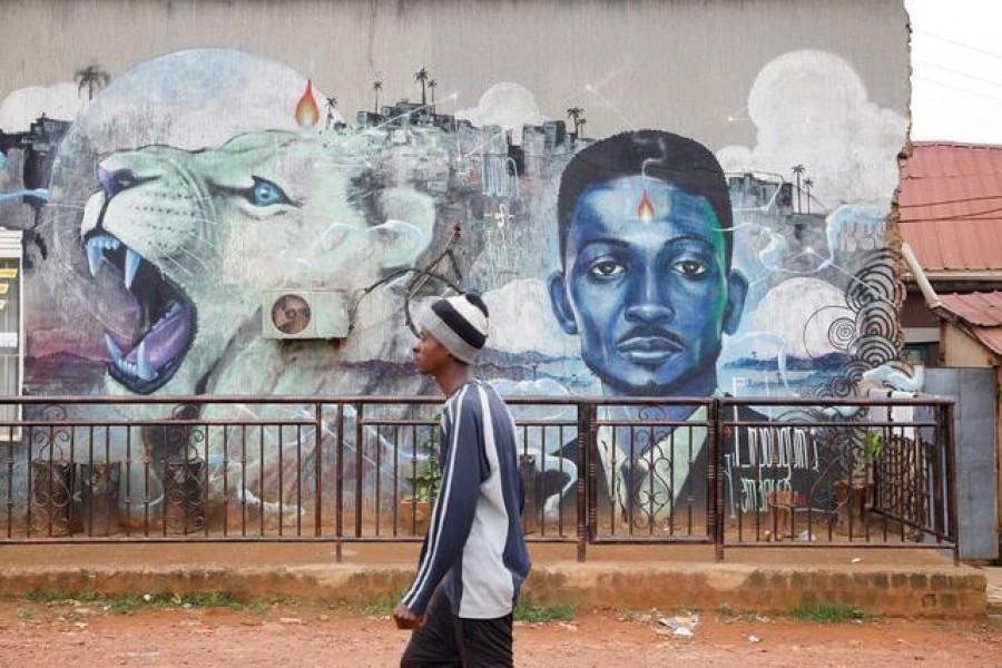 A man walks past a graffiti of Ugandan opposition presidential candidate Robert Kyagulanyi, also known as Bobi Wine, in Kampala, Uganda, January 17, 2021 — Reuters/Files