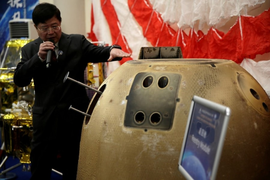 Pei Zhaoyu, spokesperson for Chang'e-5 Mission, introduces the reentry module which carried moon sample — Reuters photo