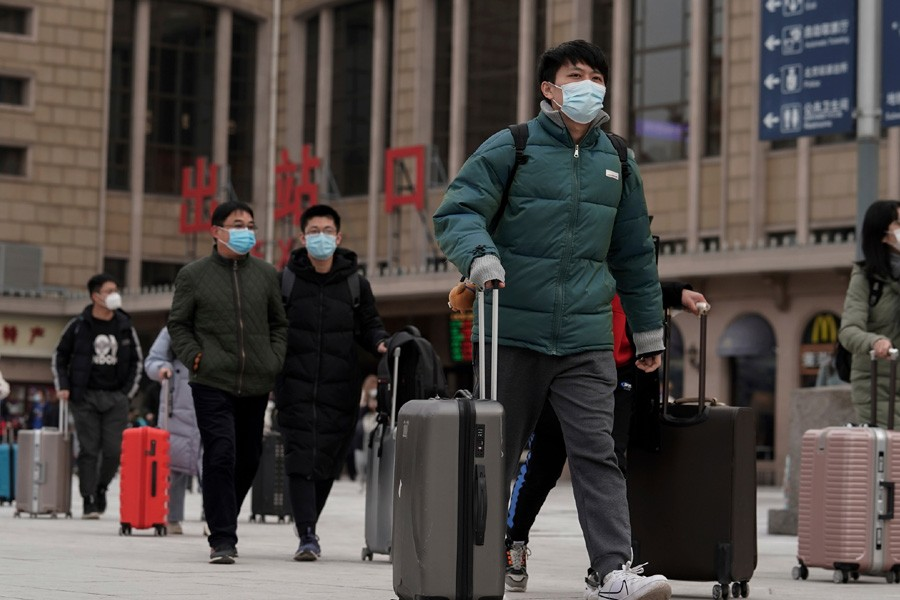 China, WHO should have acted quicker to stop pandemic, experts say