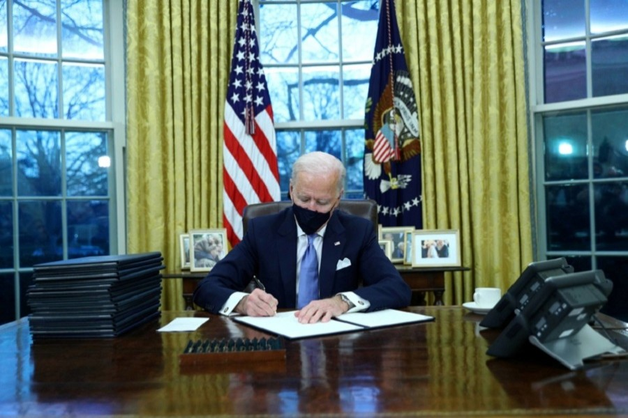 US President Joe Biden signs executive orders in the Oval Office of the White House in Washington, after his inauguration as the 46th President of the United States, US, January 20, 2021 — Reuters