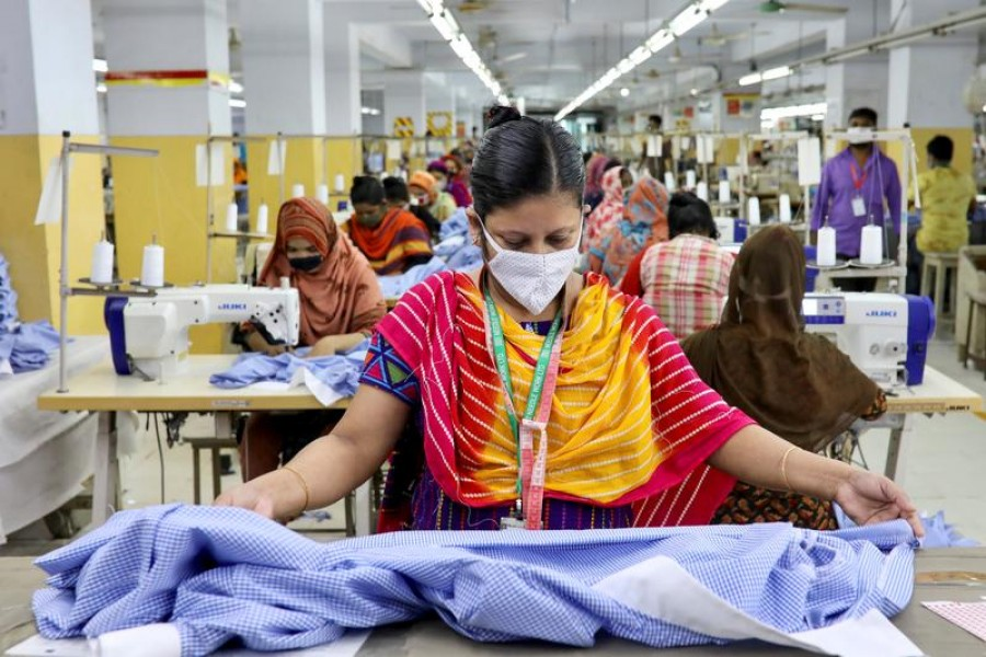 A woman works in a garment factory, as factories reopened after the government has eased the restrictions amid concerns over coronavirus disease (Covid-19) outbreak in Dhaka, Bangladesh on May 3, 2020 — Reuters/Files