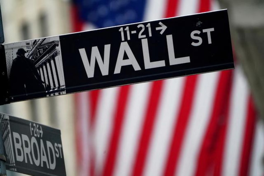 FILE PHOTO: A Wall Street sign outside the New York Stock Exchange in New York City, New York, US, October 2, 2020. REUTERS/Carlo Allegri