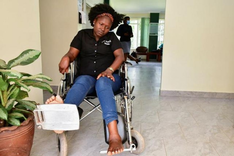 Irene Abalo, a journalist working with The Daily Monitor newspaper, sits on a wheelchair after she was injured following an attack by security officials, outside the United Nations Human Rights offices while on reporting duty, in Kampala, Uganda February 17, 2021. REUTERS/Abubaker Lubowa