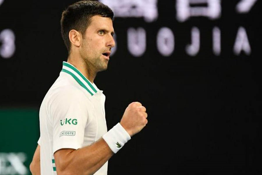 Serbia's Novak Djokovic celebrates during his semi final match against Russia's Aslan Karatsev during Australian Open at Melbourne Park, Melbourne, Australia, February, 18, 2021 — Reuters