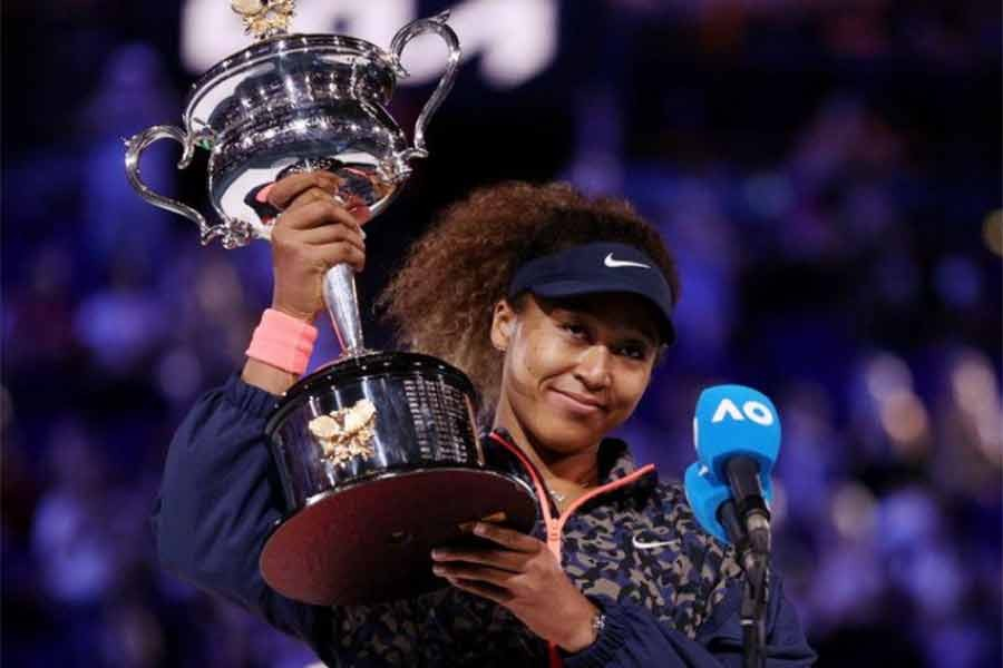 Japan's Naomi Osaka gives an interview as she celebrates with the trophy after winning her final match against Jennifer Brady of the US on Saturday -Reuters Photo