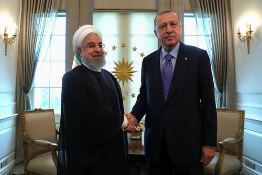 FILE PHOTO: Turkish President Tayyip Erdogan meets with his Iranian counterpart Hassan Rouhani in Ankara, Turkey, September 16, 2019. Erdem Sahin/Pool via REUTERS