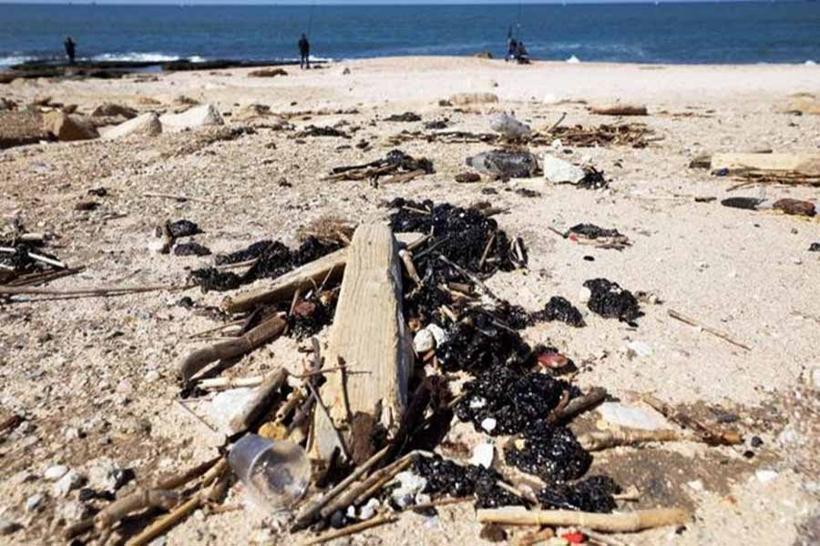 Israel's beaches blackened after offshore oil spill