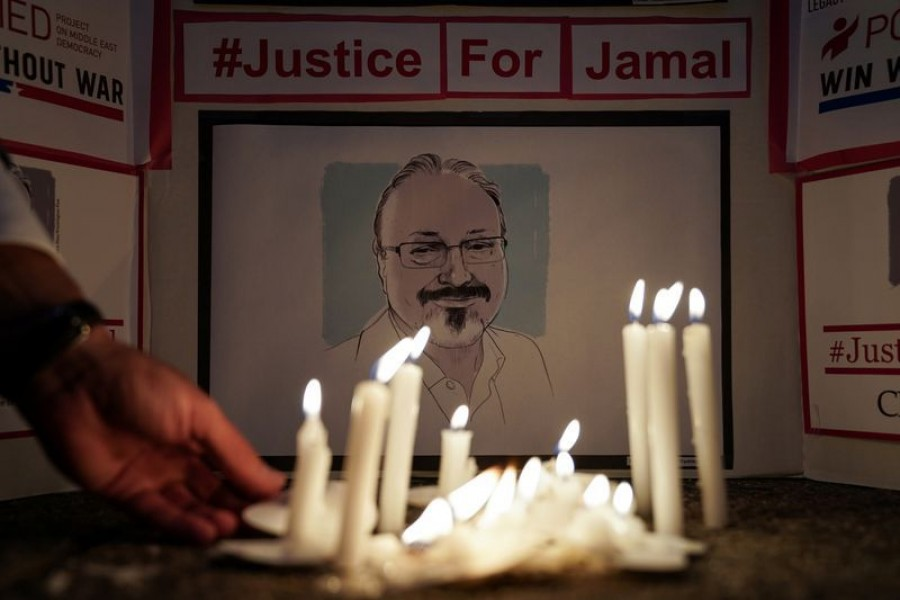 FILE PHOTO: The Committee to Protect Journalists and other press freedom activists hold a candlelight vigil in front of the Saudi Embassy to mark the anniversary of the killing of journalist Jamal Khashoggi at the kingdom's consulate in Istanbul, Wednesday evening in Washington, US, October 2, 2019. REUTERS/Sarah Silbiger
