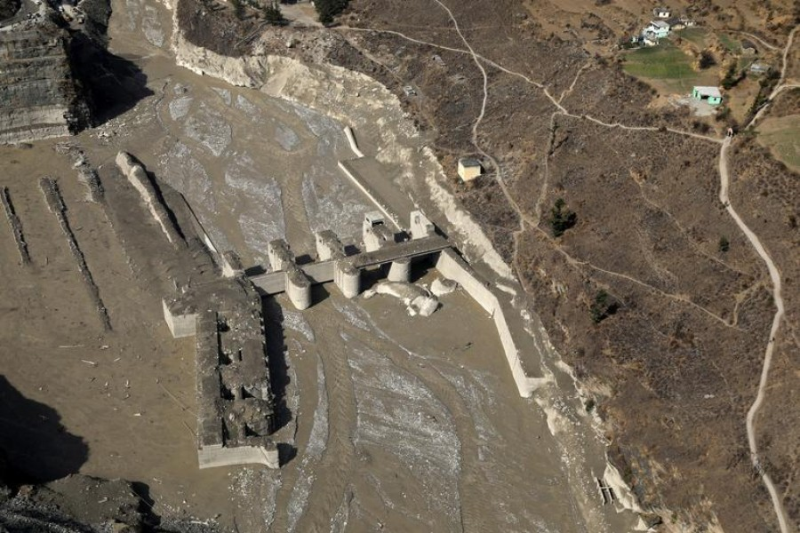 FILE PHOTO: An aerial view shows a damaged barrage after a flash flood swept a mountain valley destroying dams and bridges, in Tapovan in the northern state of Uttarakhand, India, February 12, 2021. REUTERS/Anushree Fadnavis