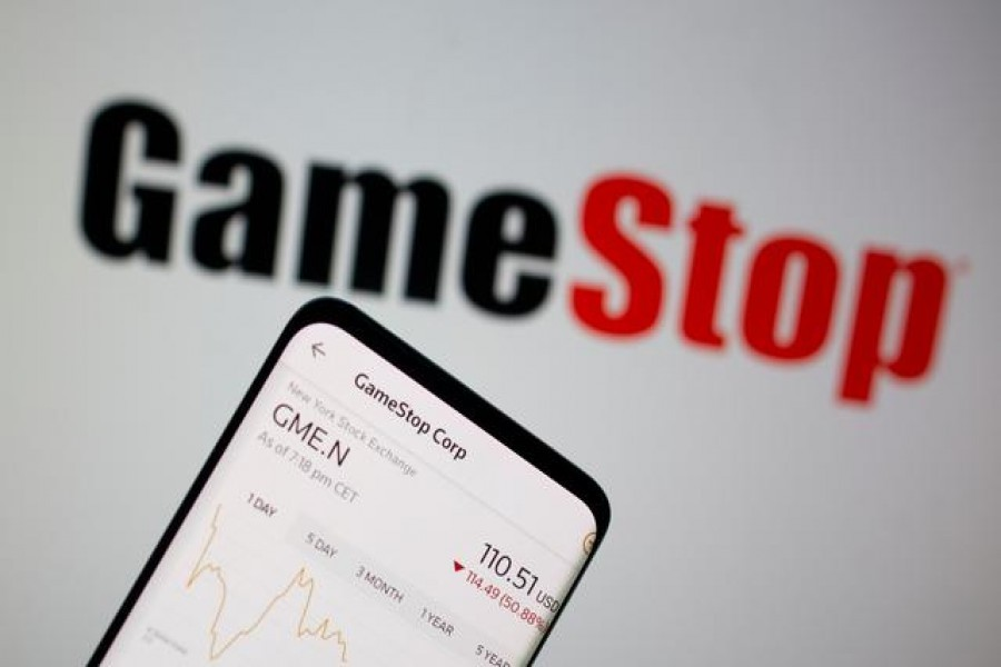 FILE PHOTO: GameStop stock graph is seen in front of the company's logo in this illustration taken February 2, 2021. REUTERS/Dado Ruvic/Illustration/File Photo