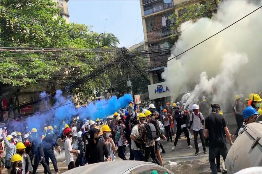 Protesters set off smoke grenades to block the view from snipers in Sanchaung, Yangon, Myanmar March 3, 2021, in this still image from a video obtained by Reuters — Video obtained by Reuters