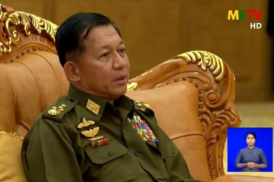 A screen grab from Myanmar state television broadcast from February 3, 2021 shows General Min Aung Hlaing speaking during a meeting — MRTV/Handout via Reuters