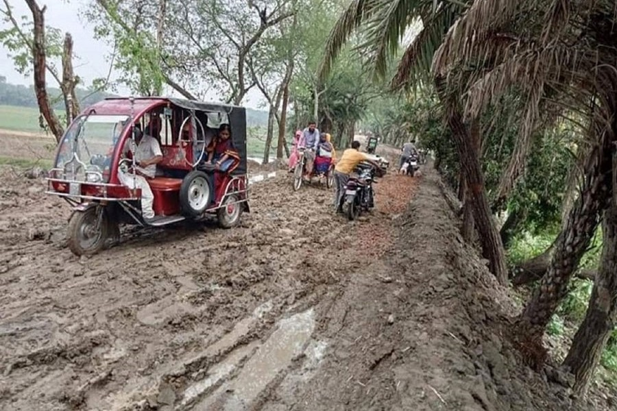 Photo shows the muddy road at Alfadanga upazila in Faridpur becomes unusable for days after one day's rain — FE Photo
