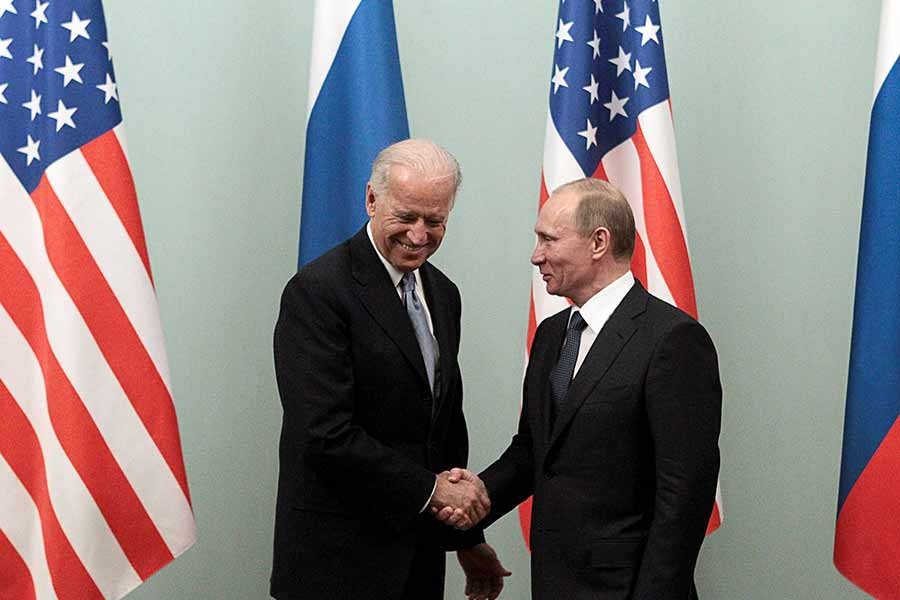 Then-US Vice President Joe Biden shaking hands with then-Russian Prime Minister Vladimir Putin during a meeting in Moscow in 2011 –Reuters file photo