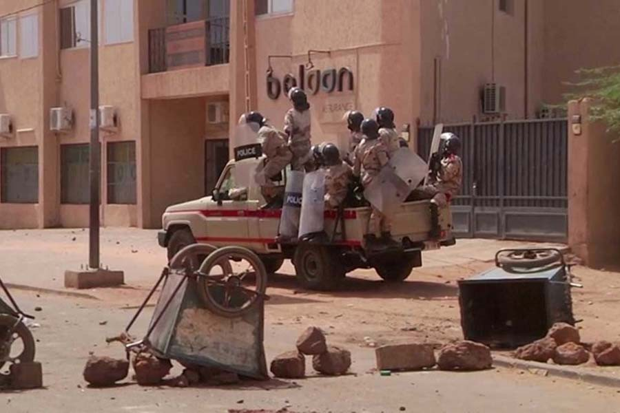Riot policemen drive towards a group of protesters at a makeshift checkpoint, a day after opposition presidential candidate Mahamane Ousmane rejected election results that gave his opponent Mohamed Bazoum a majority of the votes, in Niamey, Niger, on February 24 –Reuters file photo