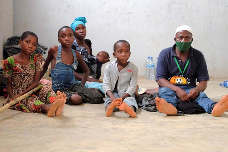 Adelino Alberto and his family who fled an attack claimed by Islamic State-linked insurgents on the town of Palma, are seen at a temporary displacement centre in Pemba, Mozambique, April 3, 2021. Picture taken April 03, 2021. REUTERS/Emidio Jozine