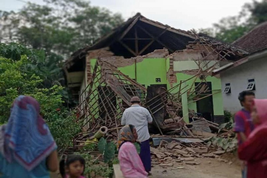 A damaged house affected by an earthquake of magnitude 5.9 struck in the ocean 91 km (57 miles) south-southeast of Blitar, is pictured in Malang, East Java province, Indonesia April 10, 2021, in this photo taken by Antara Foto/via Reuters.