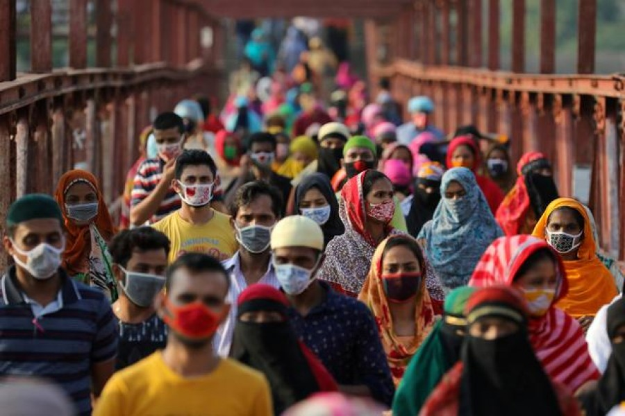 Garment workers return from a workplace as factories reopened after the government has eased the restrictions amid concerns over the coronavirus disease (Covid-19) outbreak in Dhaka, Bangladesh, May 4, 2020 — Reuters/Files