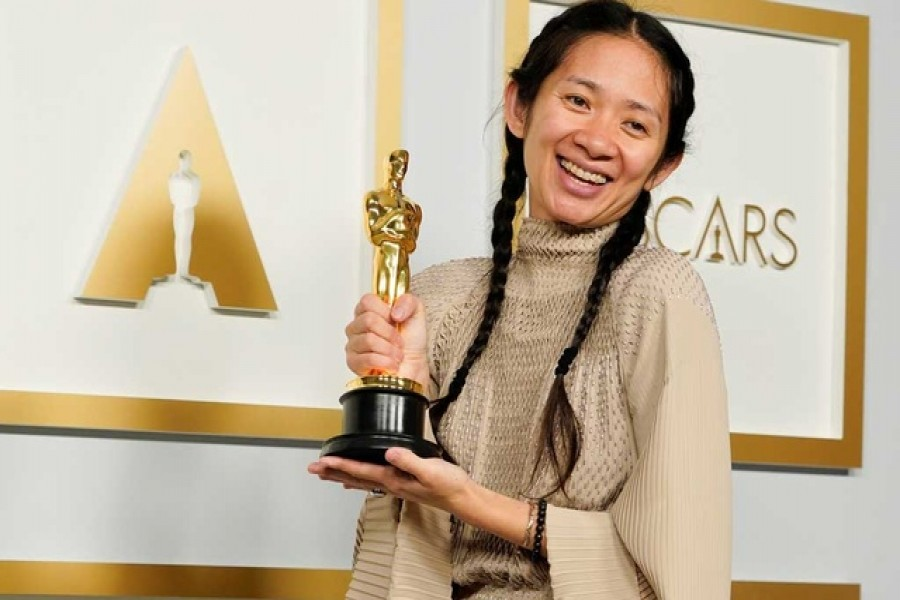 """Director/Producer Chloe Zhao, winner of the award for best picture for """"Nomadland,"""" poses in the press room at the Oscars in Los Angeles, California, US,  April 25, 2021. REUTERS"""