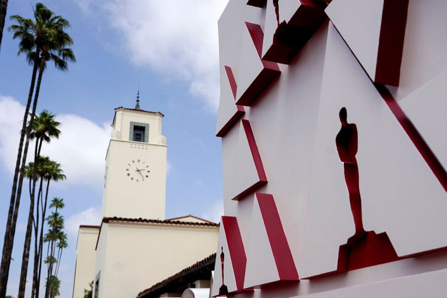 An Oscar statue design on a red carpet backdrop is pictured at Union Station, one of the locations for the 93rd Academy Awards in Los Angeles, California, US on April 24, 2021 — Pool via Reuters