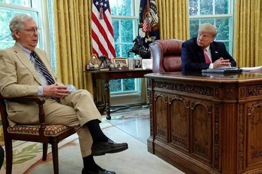 US President Donald Trump listens to Senate Majority Leader Mitch McConnell (R-KY) speak about legislation for additional coronavirus aid in the Oval Office at the White House in Washington last year -Reuters file photo