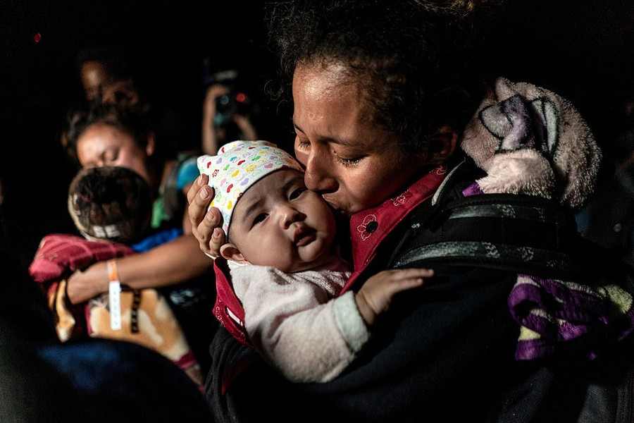 Ceidy, an asylum-seeking migrant mother from Guatemala, kisses her 3-month-old baby Bridget while waiting to be escorted by the US Border Patrol agents after crossing the Rio Grande river into the United States from Mexico in Roma, Texas, US on April 7, 2021 — Reuters/Files