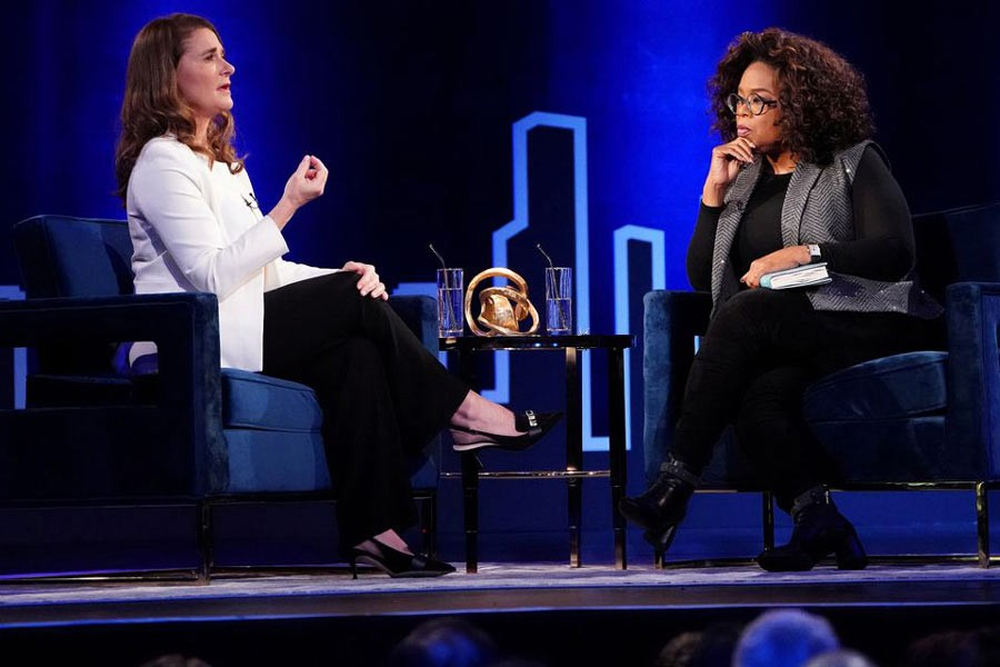 Melinda Gates (L) speaking to Oprah Winfrey on stage during a taping of her TV show in New York in 2019 -Reuters file photo