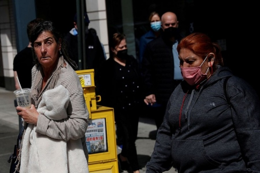 A woman walks without a protective face mask, after the Centers for Disease Control and Prevention (CDC) announced new guidelines regarding outdoor mask wearing and vaccinations during the outbreak of the coronavirus disease (COVID-19) in Manhattan, New York City, US, April 27, 2021. Reuters  A man wearing a protective mask stands outside Louis Vuitton luxury store at the Americana Manhasset open-air shopping complex in Manhasset, New York, US, May 3, 2021. Reuters A man wearing a protective mask stands outside Louis Vuitton luxury store at the Americana Manhasset open-air shopping complex in Manhasset, New York, US, May 3, 2021. Reuters  PreviousNext