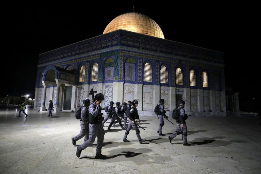 Israeli police walk near the Dome of the Rock during clashes with Palestinians at a compound known to Muslims as Noble Sanctuary and to Jews as Temple Mount, amid tension over the possible eviction of several Palestinian families from homes on land claimed by Jewish settlers in the Sheikh Jarrah neighbourhood, in Jerusalem's Old City on May 7, 2021 — Reuters photo