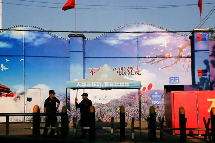 Security guards stand at the gates of what is officially known as a vocational skills education centre in Huocheng County in Xinjiang Uighur Autonomous Region in China -Reuters photo