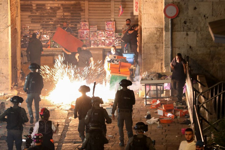 Palestinians react as Israeli police fire a stun grenade during clashes at Damascus Gate on Laylat al-Qadr during the holy month of Ramadan, in Jerusalem's Old City on May 9, 2021 — Reuters photo
