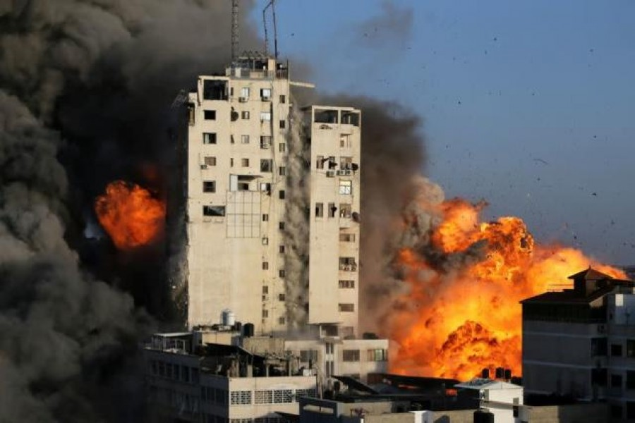 Smoke and flames rise from a tower building as it is destroyed by Israeli air strikes amid a flare-up of Israeli-Palestinian violence, in Gaza City on May 12, 2021 — Reuters photo