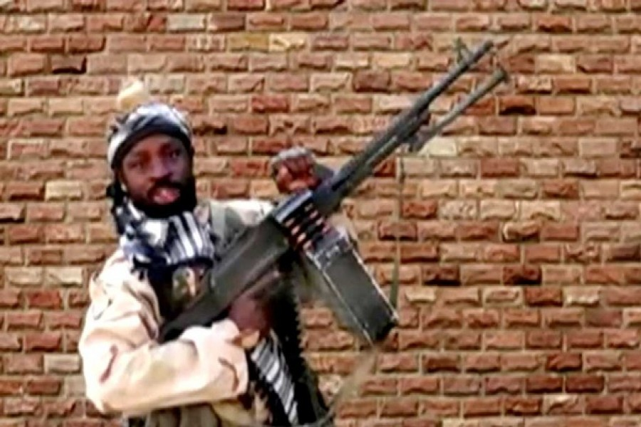 Boko Haram leader Abubakar Shekau holds a weapon in an unknown location in Nigeria in this still image taken from an undated video obtained on Jan 15, 2018 - Reuters photo