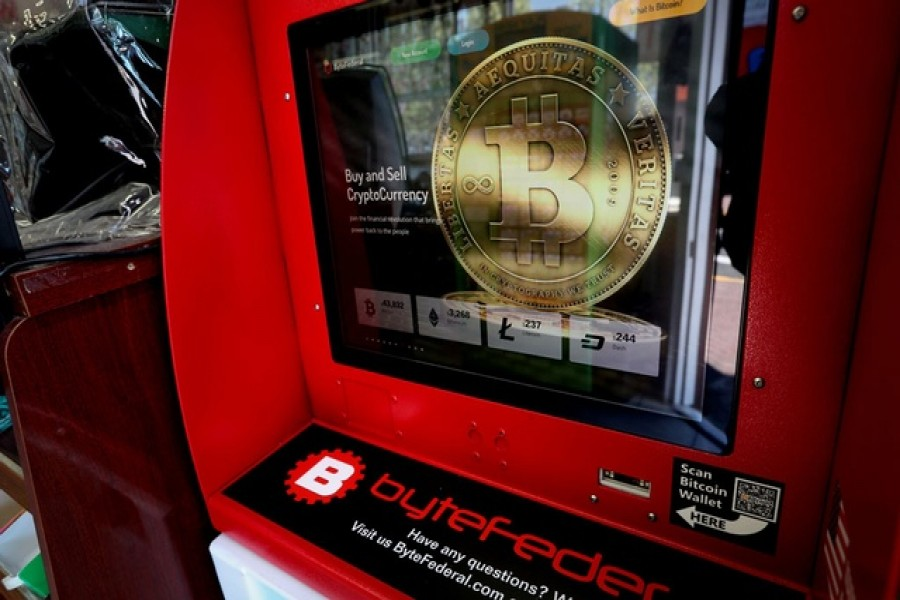 A cryptocurrency ATM machine is pictured in a shop in Union City, New Jersey, US, May 19, 2021. Reuters