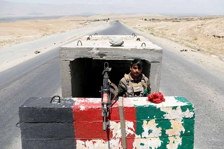 An Afghan National Army soldier standing guard at a checkpoint near Bagram US air base Parwan province in Afghanistan on July 2 on the day the last of American troops vacated it -Reuters file photo