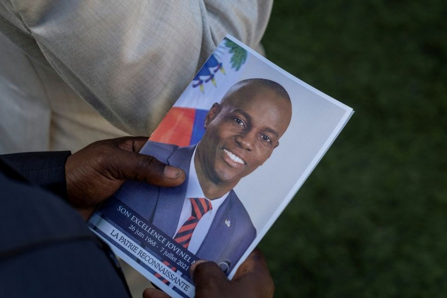 A person holds a photo of late Haitian President Jovenel Moise, who was shot dead earlier this month, during his funeral at his family home in Cap-Haitien, Haiti on July 23, 2021 — Reuters/Files