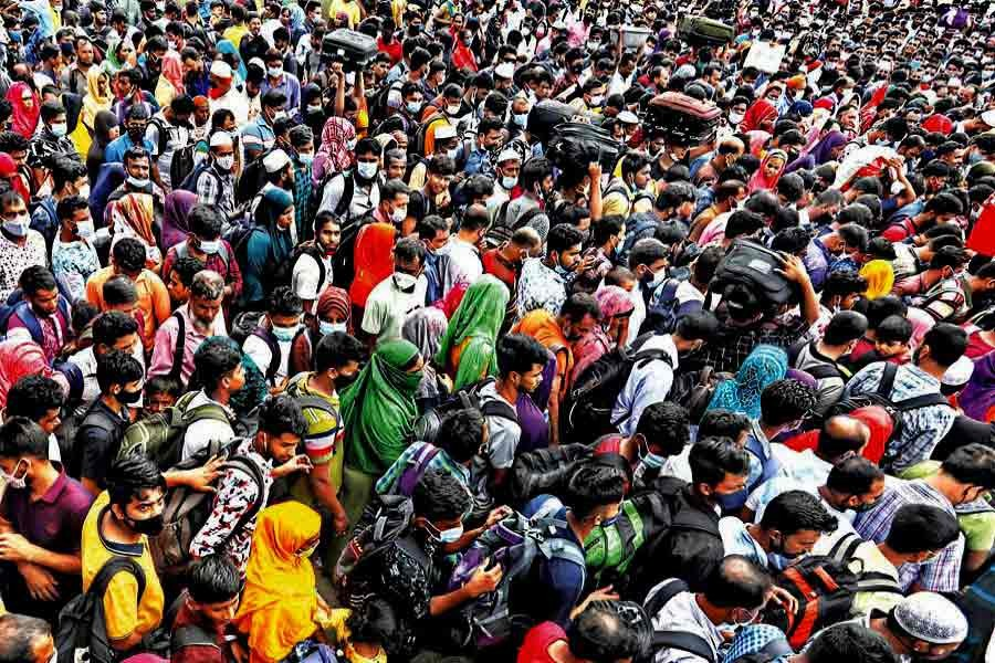 People, mostly factory workers, packed like sardines in a ferry arrive at Shimulia ferry terminal in Munshiganj on Saturday on their way to Dhaka following the government's sudden announcement about reopening of factories amidst the ongoing lockdown —FE photo