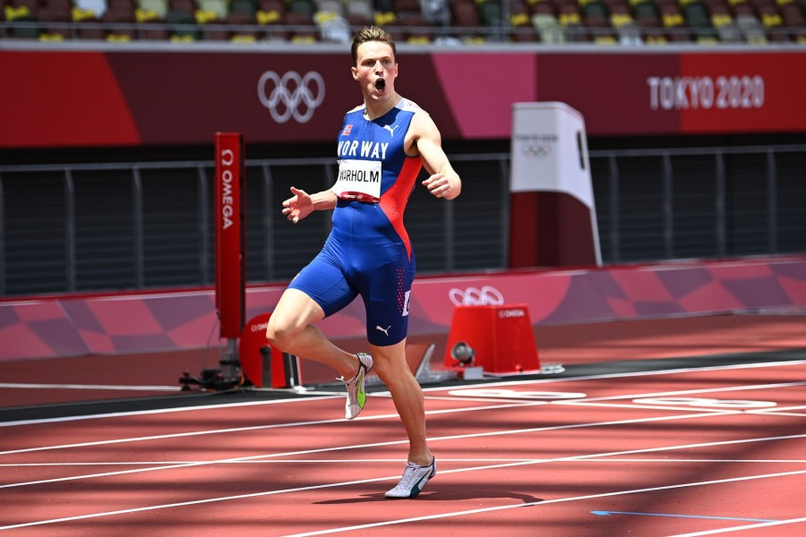 Tokyo 2020 Olympics - Athletics - Men's 400m Hurdles - Final - Olympic Stadium, Tokyo, Japan - August 3, 2021. Karsten Warholm of Norway celebrates after winning gold and setting a new world record REUTERS/Dylan Martinez